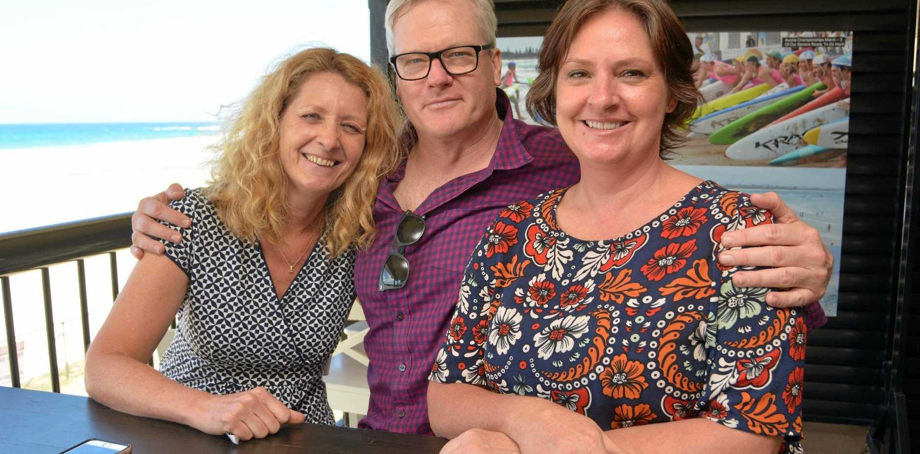 Boardwalk Books owner Debbie Allen (left) and assistant Katrina Rosetta welcome author and actor William McInnes to a book-signing at Cudgen Surf Club.