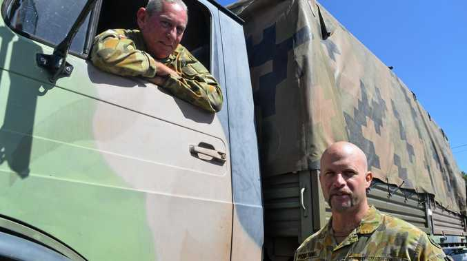 Corporal Steve Zahra has been a part of Mackay's 31st/42nd Battalion for 28 years, while Private Iain Poulton has been with it for 18 months.