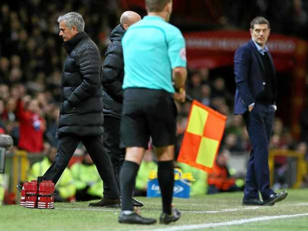 Manchester United's manager Jose Mourinho walks to the stands after being sent off.