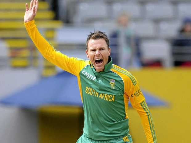 Johan Botha celebrates a dismissal playing for South Africa.