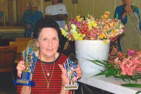 LEFT: Betty Fernance with some of the trophies she won for her flowers.