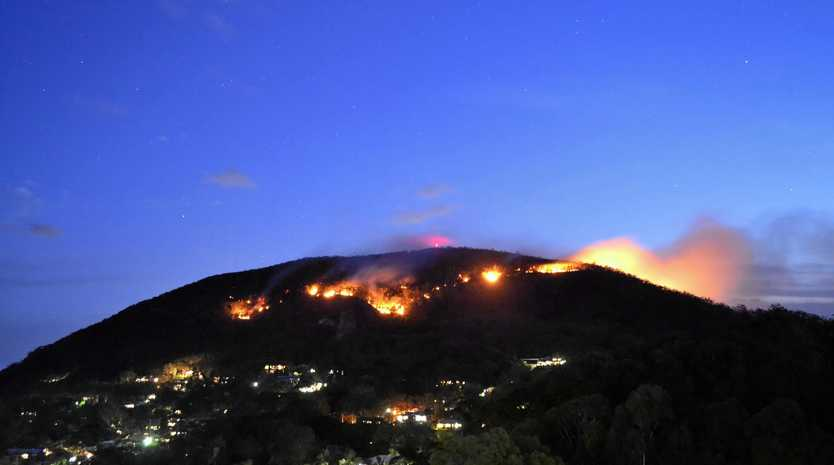The Mt Coolum walking track has been reopened to the public after being closed for a few days while bushfires spread across the mountain.