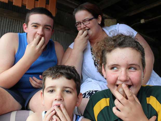 Cassie Stone and her children Jackson, Chad and Chonteal share a Kinder Surprise in honour of Robert Agius.