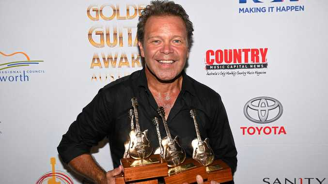 Troy Cassar-Daley poses for a photograph after winning five Golden Guitar's, at the 44th annual Golden Guitar Awards during the Tamworth Country Music Festival, in Tamworth, Saturday, Jan. 23, 2016. The Tamworth Country Music Festival runs from the 15th to 24th January, culminating in the Golden Guitar Awards night which celebrates the best of Australian country music. (AAP Image/Dan Himbrechts) NO ARCHIVING