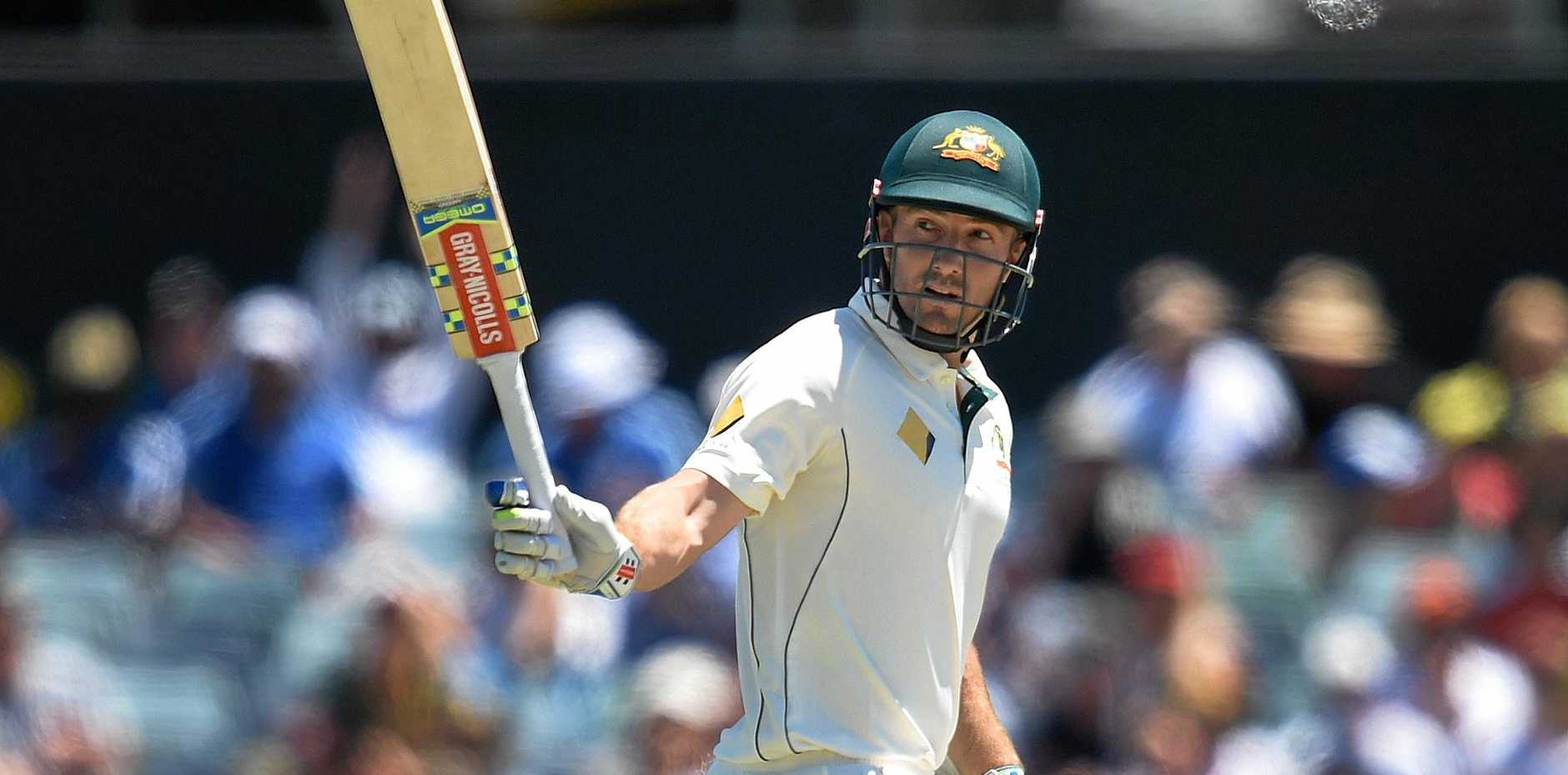 Australian batsman Shaun Marsh raises his bat after reaching a half century on day two of the first Test against South Africa at the WACA.