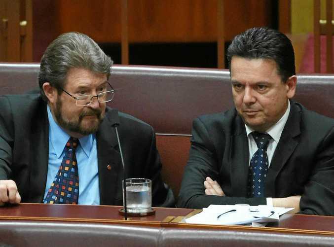 UNDER FIRE: Senators Derryn Hinch and Nick Xenophon.