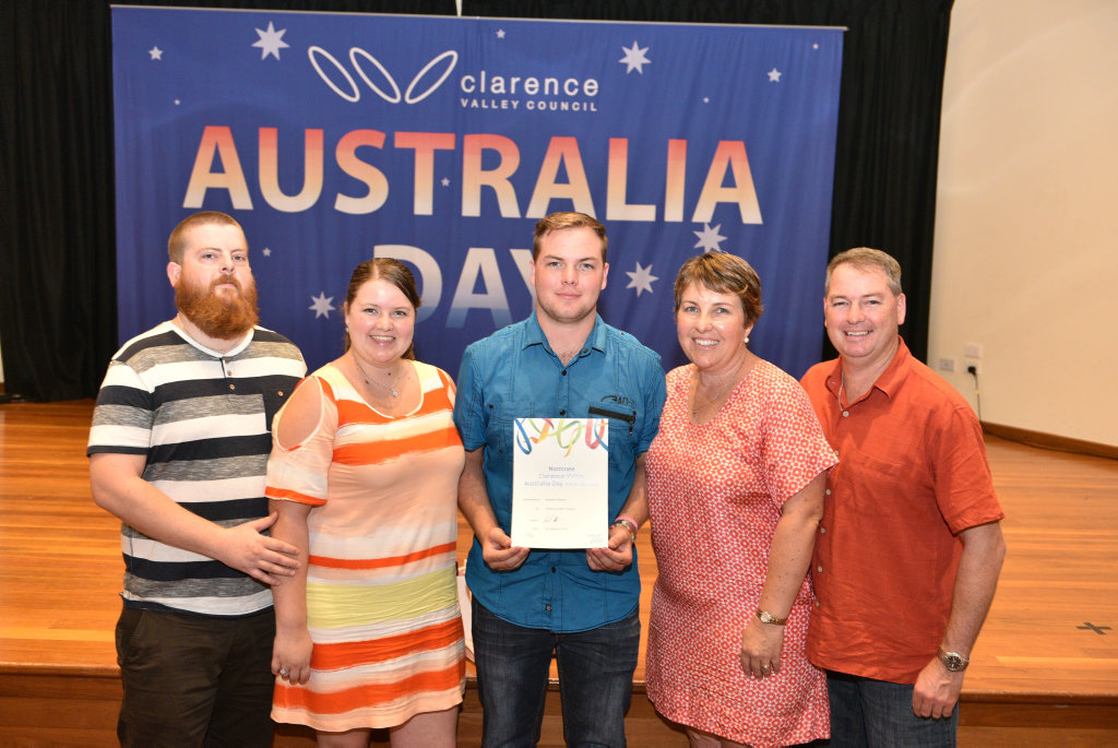 Brandon Disson is surrounded by his family after his nomination for young citizen of the year at the Australia Day awards at Yamba Golf Club.