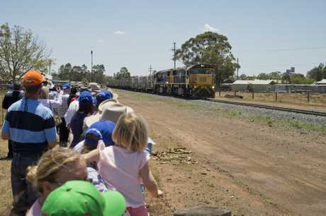 Hundreds watch as the train arrives at Oakey Beef Exports.