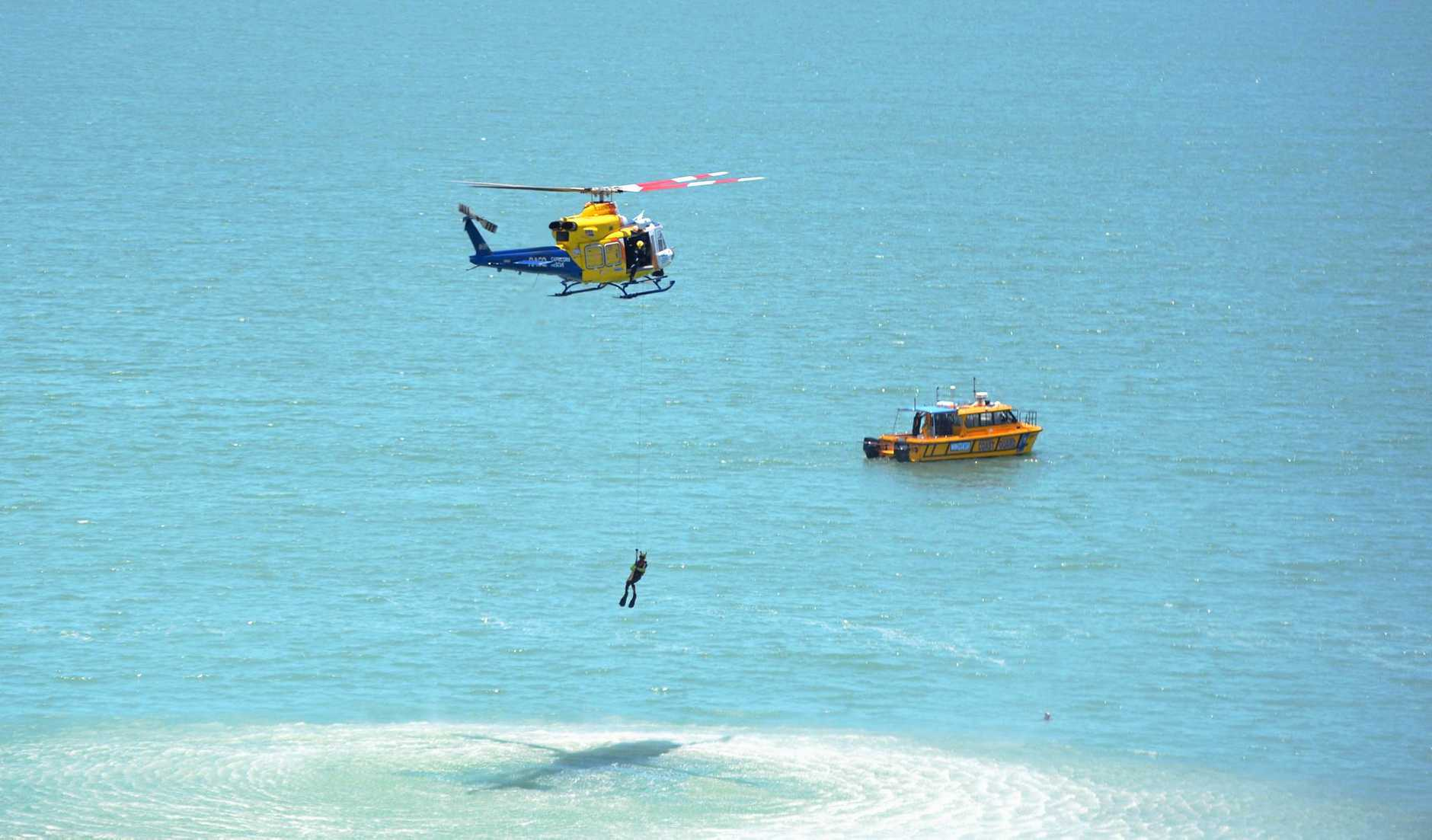 Spectators gathered at Wreck Point today to watch in awe as the RACQ Capricorn Rescue helicopter trained with the Volunteer Coastguard.