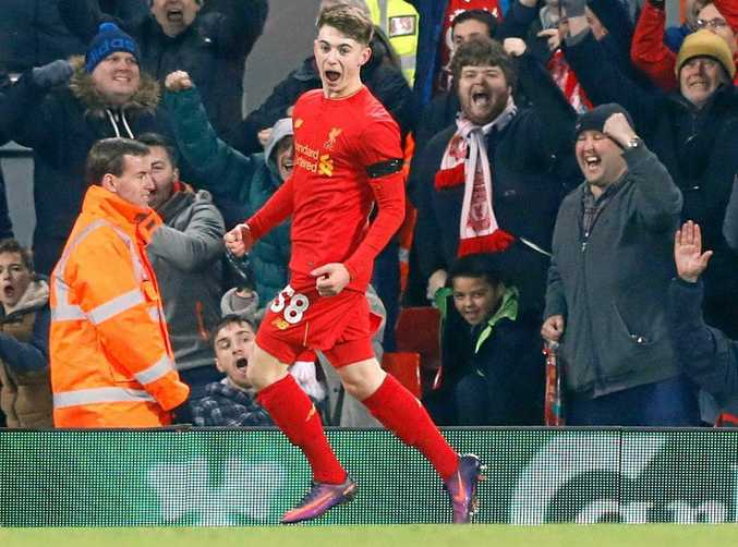 Liverpool's Ben Woodburn celebrates scoring his side's second goal against Leeds United at Anfield.