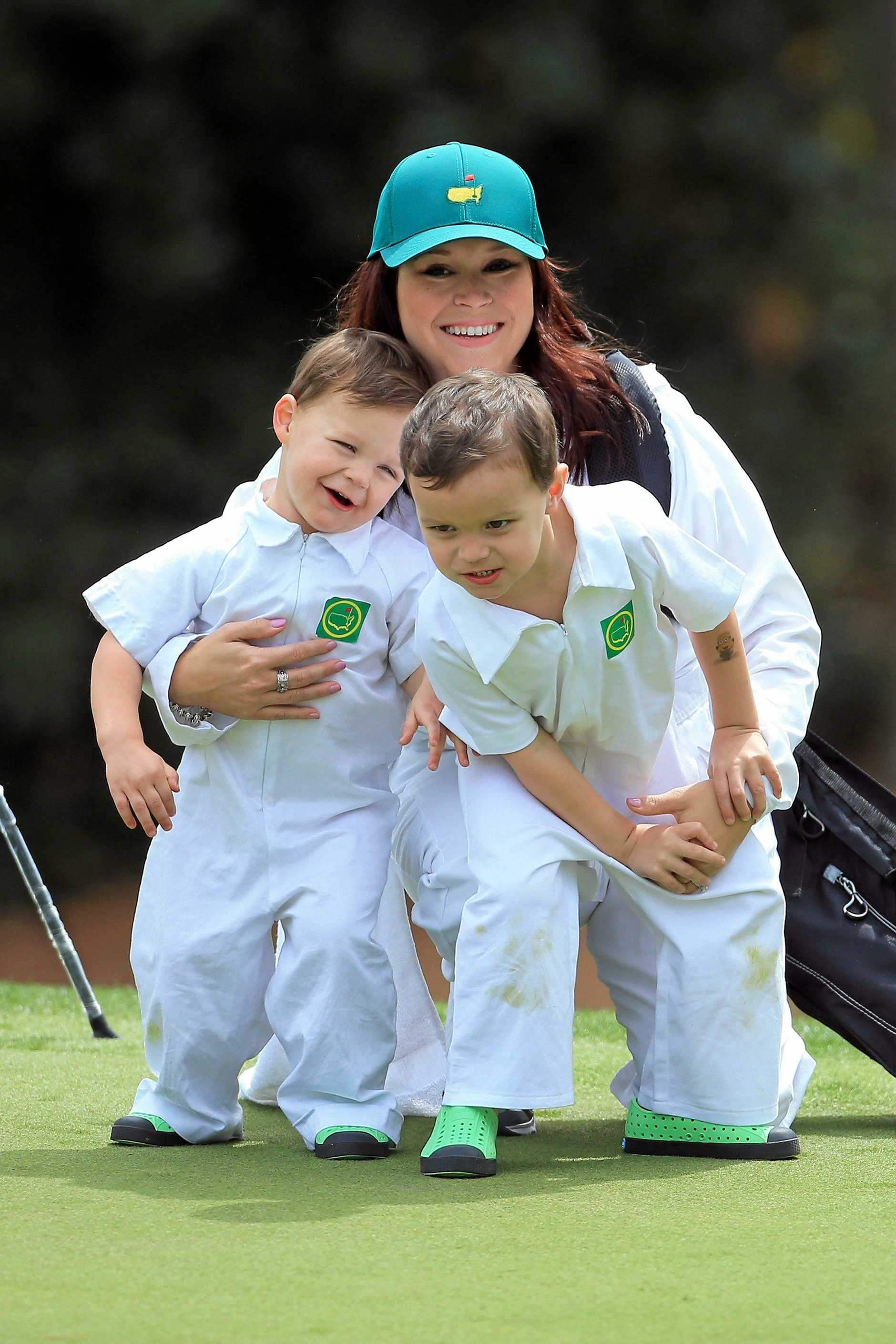 AUGUSTA, GEORGIA - APRIL 06:  Wife of Marc Leishman of Australia, Audrey Hills and their sons Oliver and Harvey attend the Par 3 Contest prior to the start of the 2016 Masters Tournament at Augusta National Golf Club on April 6, 2016 in Augusta, Georgia.  (Photo by David Cannon/Getty Images)