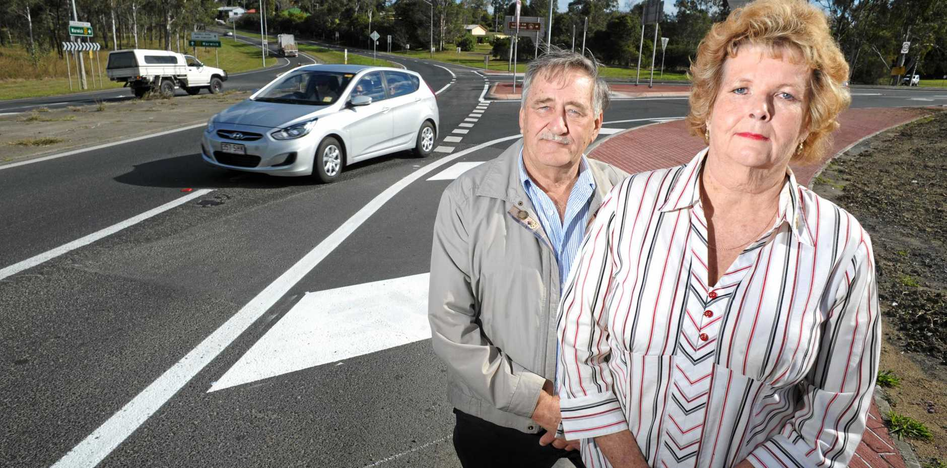 FIX THIS: George Hatchman and Scharmaine Harrold on the Cunningham Highway intersection at Amberley. Residents are still sick of the lack of action on the Willowbank Interchange.