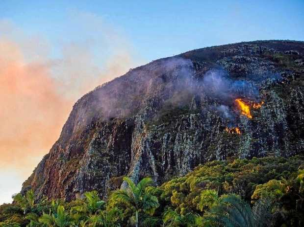 ARSON: Fire burns on the north-eastern side of Mount Coolum. Police say the fire, which is still burning, may have been deliberately lit.