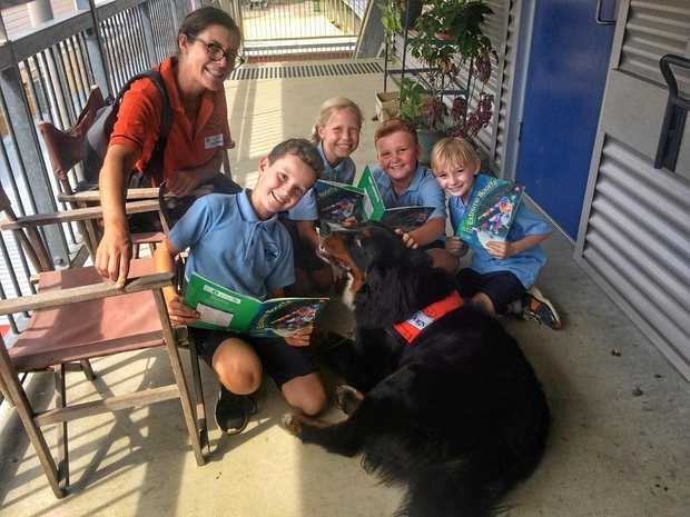 STORY DOGS: Students from Byron Bay High School, Kori Tasker, Coco Cratchley, Nathan Smith and Beau Learmonth with Attila the story Dog.