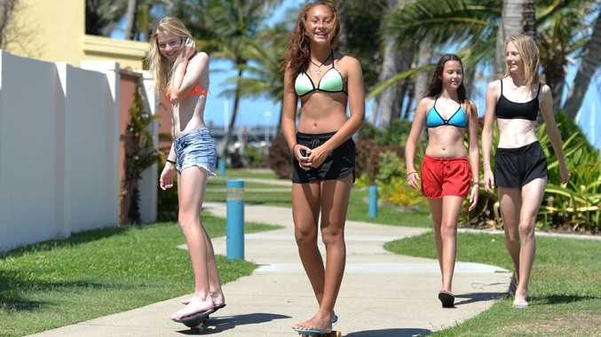 BLUE SKIES: Tia Kelly, Jasmine Chapman, Lilli Axisa and Zoe McIntyre take advantage of great summer weather at Mackay Harbour yesterday. Temperatures hovered around 28 degrees but a heatwave is in store, with a high of 35 degrees forecast for Wednesday.