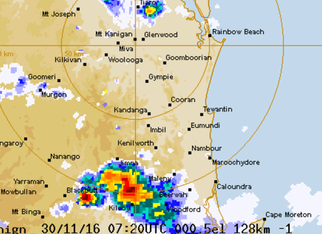 An image from the BOM's radar shows the storm's centre hitting the hinterland.