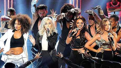Aaron Renfree dances with British band Little Mix