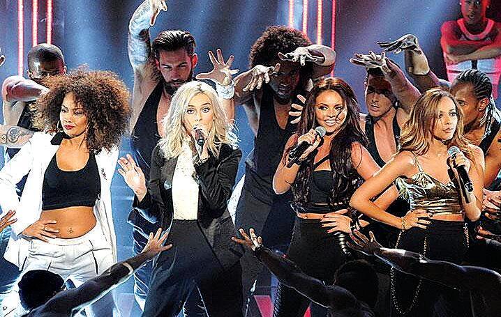 Aaron Renfree dances with British band Little Mix