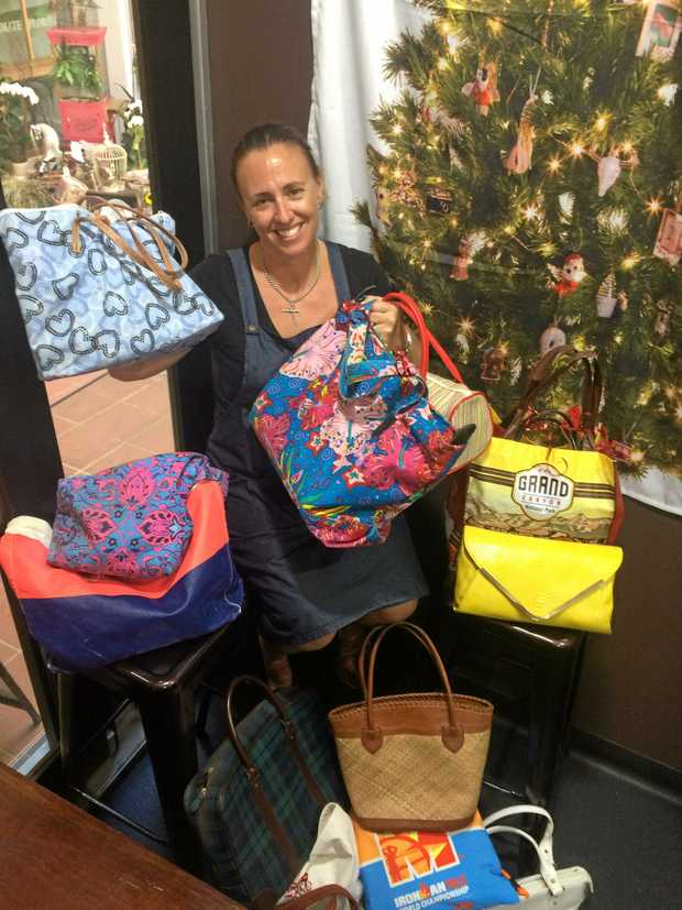 BAG ON IT: Jo Wilson with some of the donated bags.