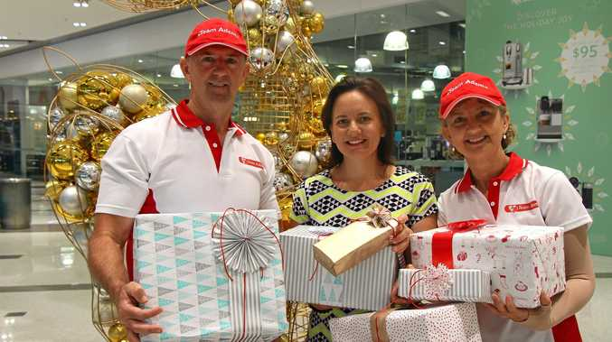 WRAPPING UP: Team Adem wrap up the year with their annual Christmas donation drive, supported by the Homemaker Centre. Brent Crosby, Rebecca Gill and Lu Crosby.