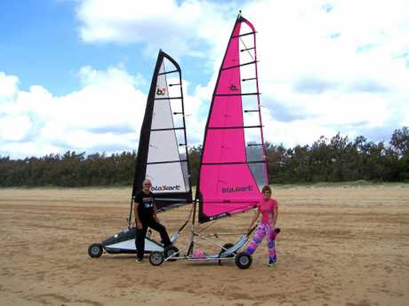 SPLASH OF PINK: Tony and Kate Francis, wearing her psychedelic pink jeans with her bright, new sails at the Cape Hillsborough Blokart regatta on Salonika Beach.