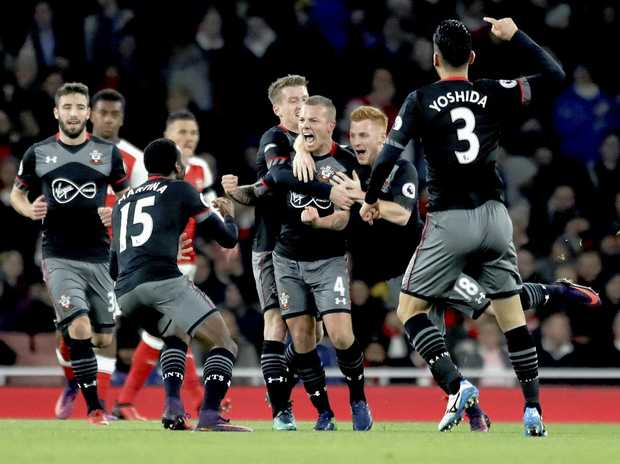 Southampton's Jordy Clasie (centre) celebrates scoring his side's first goal during the English Football League Cup quarter-final against Arsenal at the Emirates in London.
