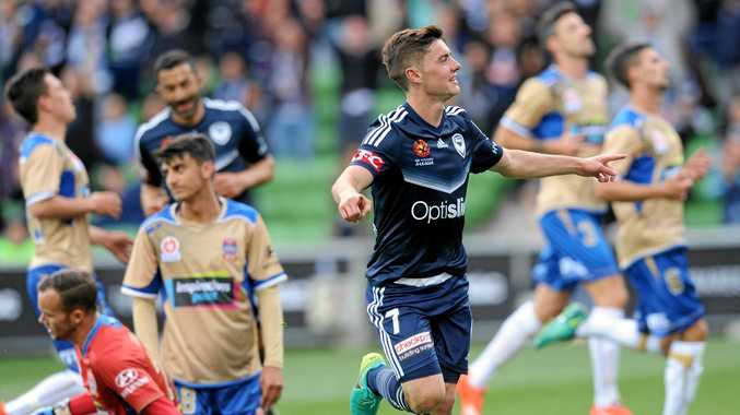 Marco Rojas of the Melbourne Victory celebrates after scoring against the Jets.