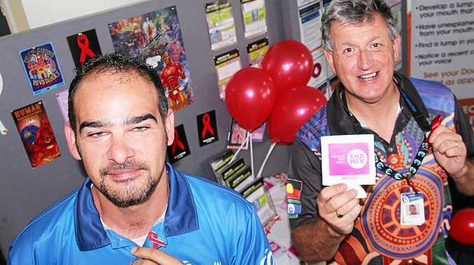 Pictured (from left) Clinical Nurses Jethro Romer and Gary Wright promoting World AIDS Day and Rockhampton Blood Borne Virus and Sexual Service
