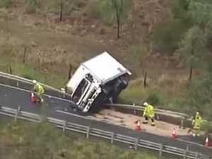 Motorist hurt in truck rollover near Lake Wivenhoe