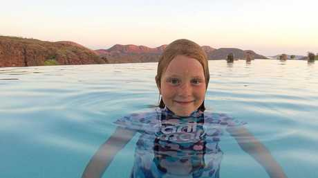 Kyla Sundstrom swims in a swimming pool over Lake Argyle, Western Australia