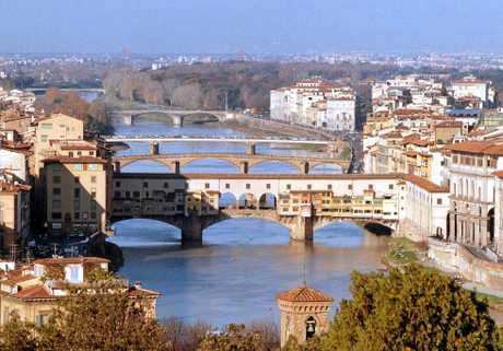 Bridges span the Arno river in Florence. In the foreground is the Ponte Vecchio, one of Florence's many popular tourist destinations.