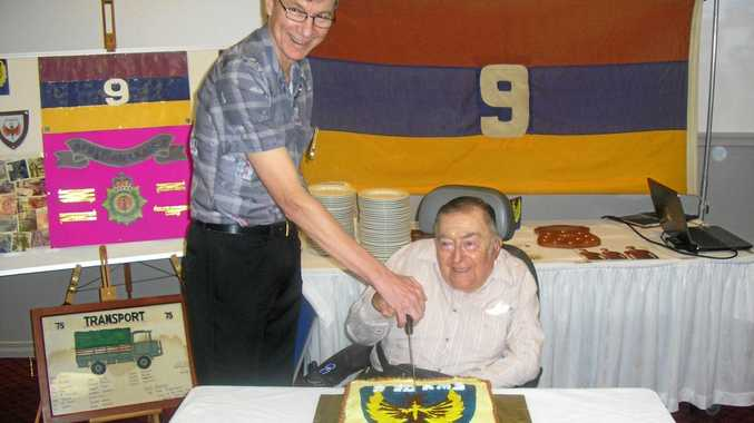 REUNITED: Lieutenant Len Stevens (retired) and Captain Michael Delaney cut the celebration cake at the 100 Years of Service Commemorative Reunion for 9 Field Ambulance on Saturday night.