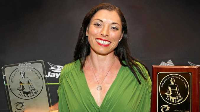 CHAMPION: Laurelea Moss celebrates her national cycling awards at the gala dinner in Melbourne.