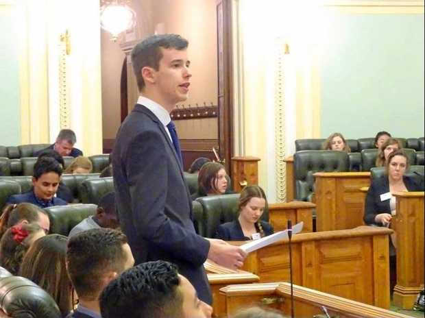 MAKING A DIFFERENCE: Year 11 student Shaun McAnally speaking in the Queensland Youth Parliament.
