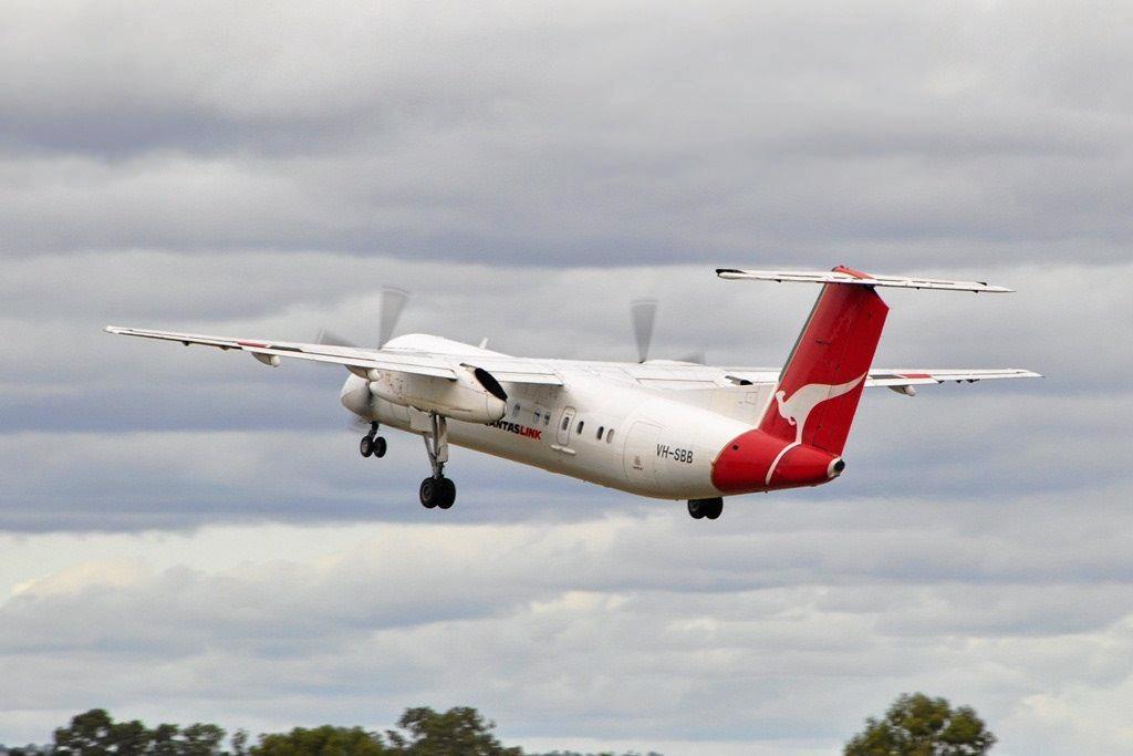 BON VOYAGE: A QantasLink Q300 flies out of Thangool Aerodrome in 2014.