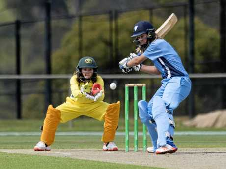 NSW Metro's Carly Leeson unleashes on a ball during the Cricket Australia Under 18 Female National Championships in Hobart.