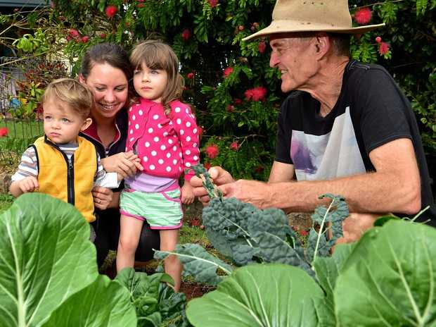 GARDENING BLUES: Duncan McNaught, one of the driving forces behind the Urban Food Street initiative at Buderim, with Joshua, 1, Amy, and Gabrielle Diesel, 3. File photo.