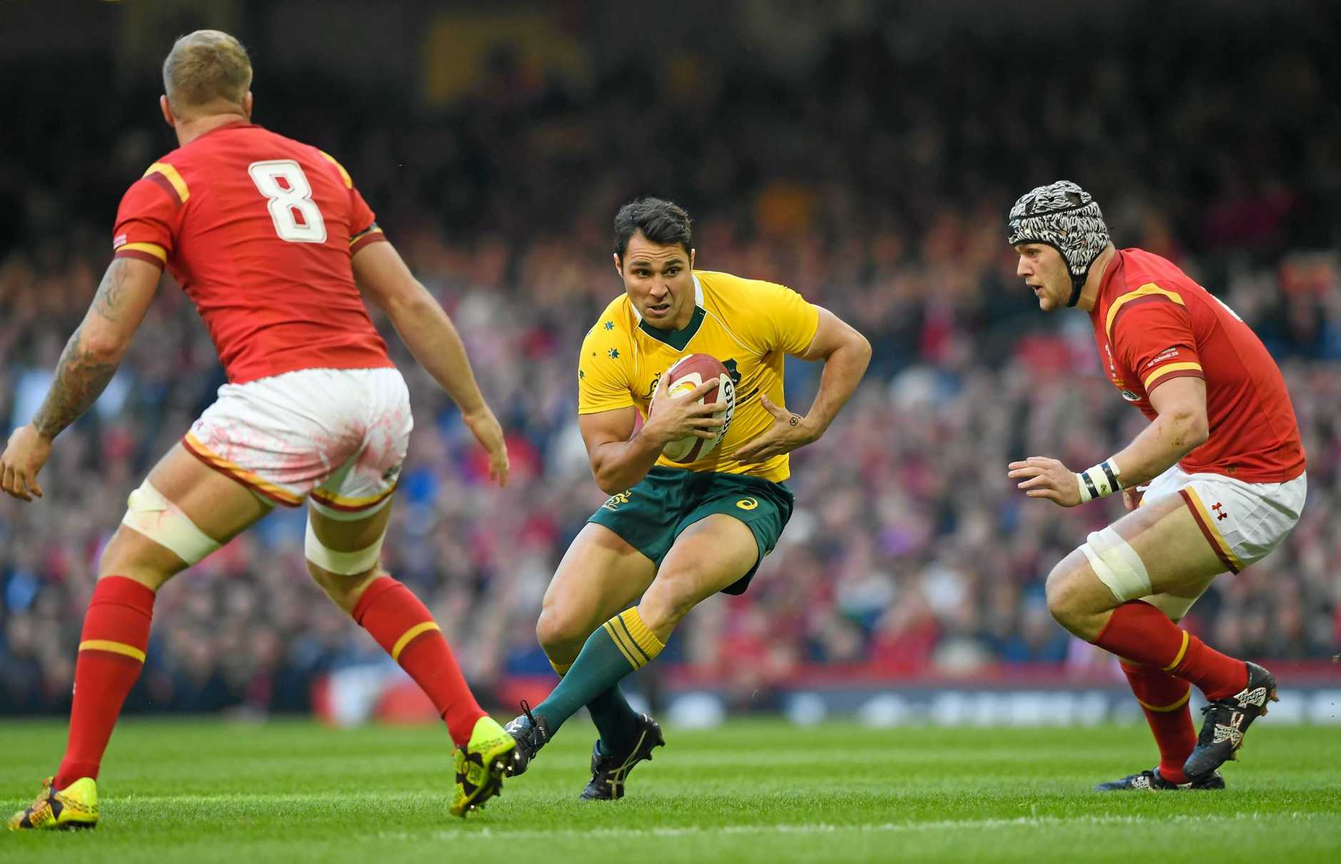 Nick Phipps of Australia looks for a gap against Wales.