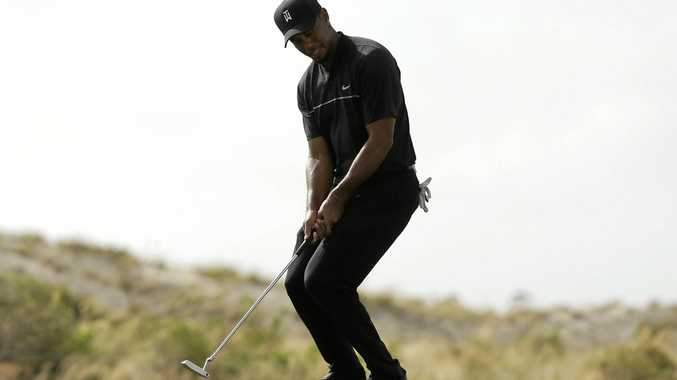 Tiger Woods reacts after missing putt on the 11th hole during the first round at the Hero World Challenge in the Bahamas.