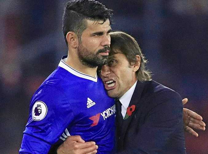 Chelsea's Diego Costa is embraced by manager Antonio Conte.