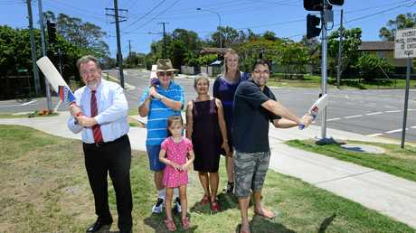 CENTURION: Cr Paul Tully, Robert and Isabel Dow with granddaughter Ava Bowers, 5, Cr Cheryl Bromage and Shane Barnes celebrate Ipswich's 100th set of traffic lights on the corner of Albert and Alice Street, Goodna.