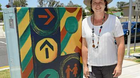 Artist Andrea Moser has painted the artwork to cover the control box for Ipswich's 100th set of traffic lights on the corner of Albert and Alice Street, Goodna.