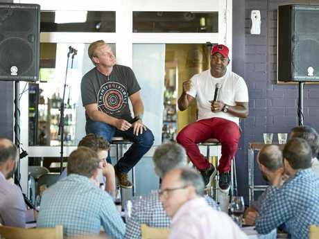 SHARING SESSION: Justin Karcher (left) listens in as cricket legend Brian Lara shares a story with the crowd at The Spotted Cow.