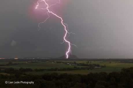Lightning strikes in front of Mount Coolum.
