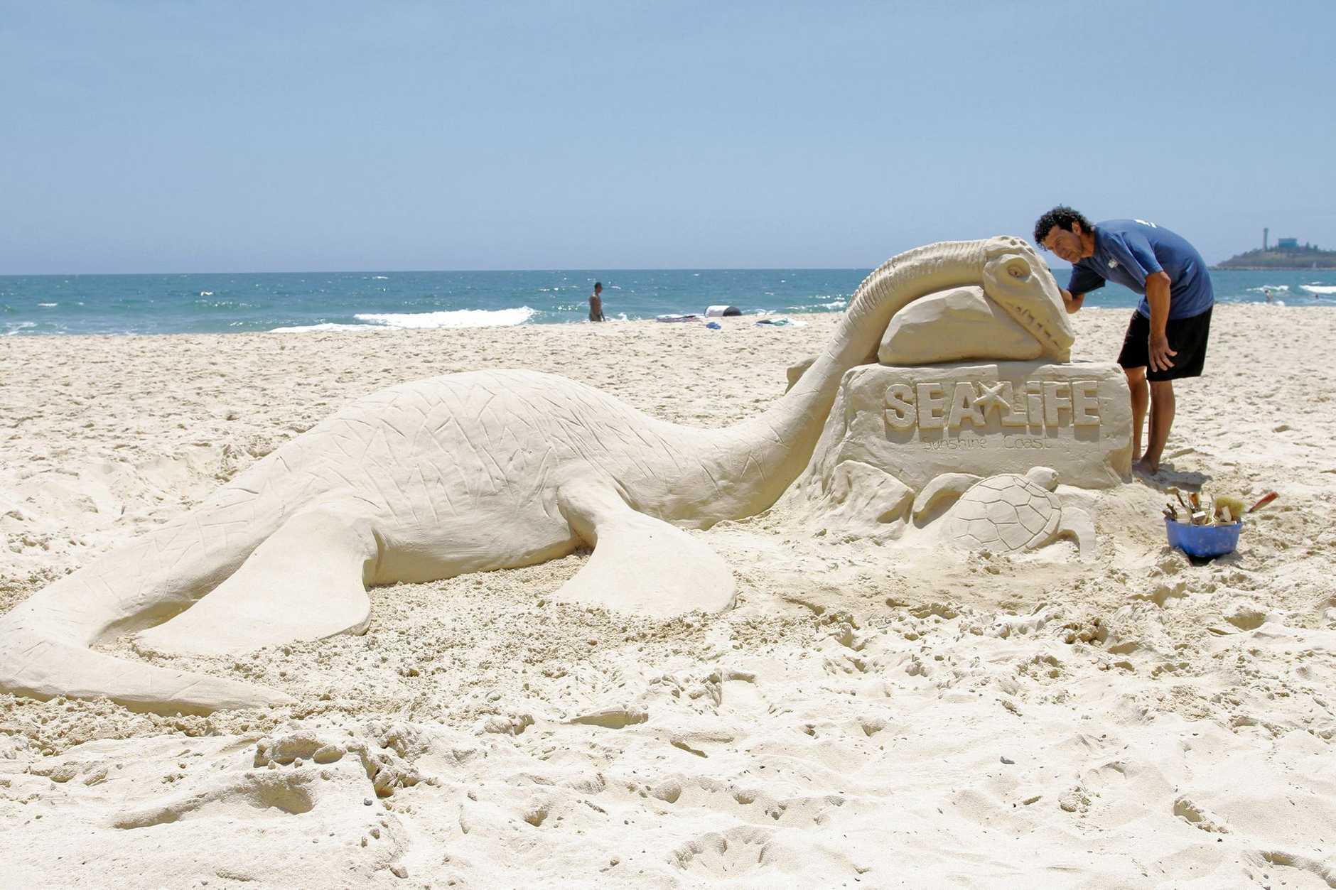 Peter Papamanolis with the Jurassic Seas sculpture.