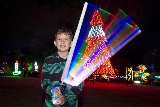 William Cupitt goes Star Wars at Toowoomba's Christmas Wonderland Christmas lights display in Queens Park Botanical Gardens.