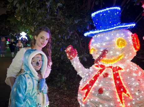 Victoria Letheby (back) and Isabel Graham admire a snowman at Toowoomba's Christmas Wonderland Christmas lights display in Queens Park Botanical Gardens, Saturday, December 03, 2016.