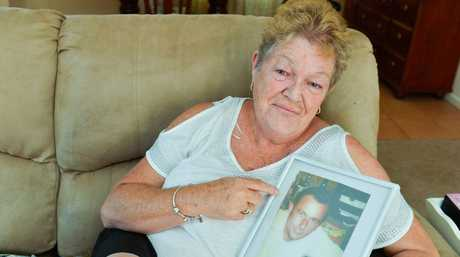 Marlene Snoodyk with a photo of her husband Leo.