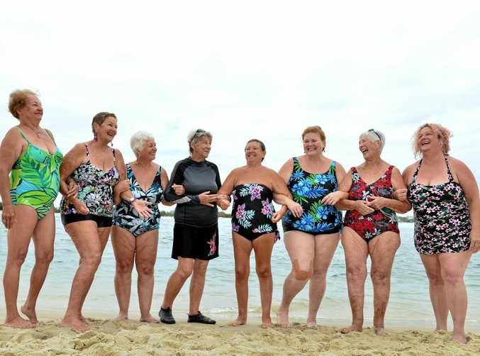 RINGING IN THE YEARS: Gisela Mackay, Tracey Heers, Rae Rashford, Suzanne Baker, Isabel Hoey, Dot Collins, Bee Schlaikier and Melissa Todd at Bulcock Beach as part of a regular swimming group, The Bulcock Belles.