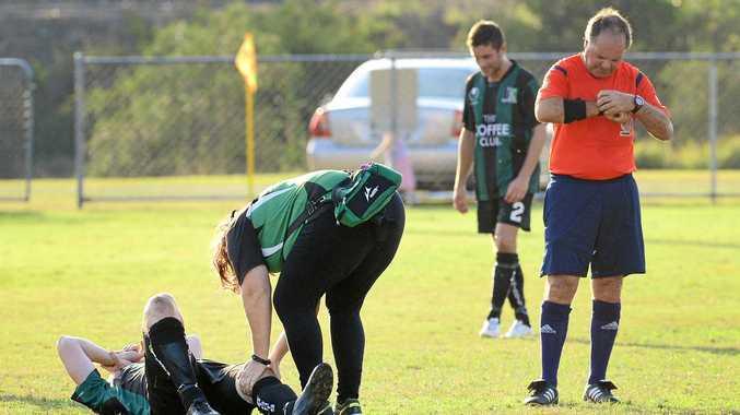 Ipswich Knights footballer Adam O'Sullivan receives immediate treatment after suffering a serious knee injury.